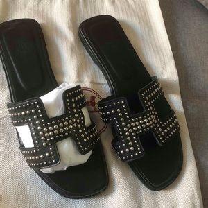 Hermes Oran black sandals with studs